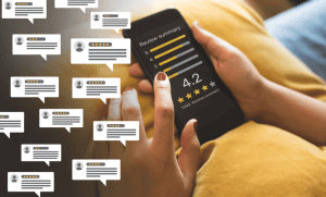a person holding a phone looking at reviews of a brand