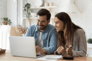 two happy customers looking at a website